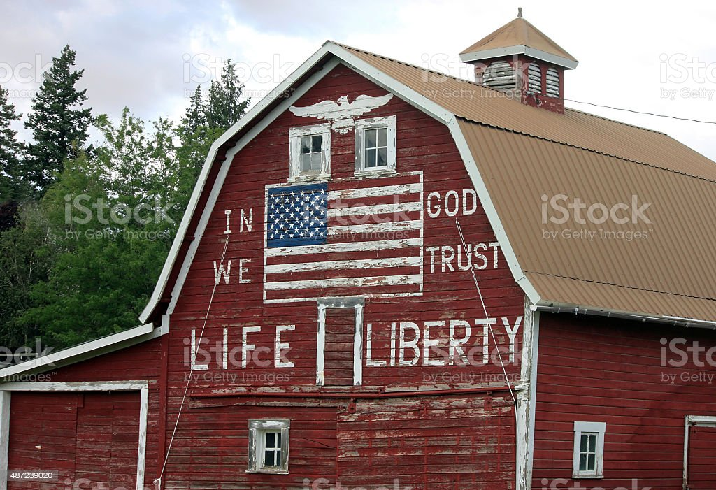 Patriotic Red Barn with Painted American Flag stock photo