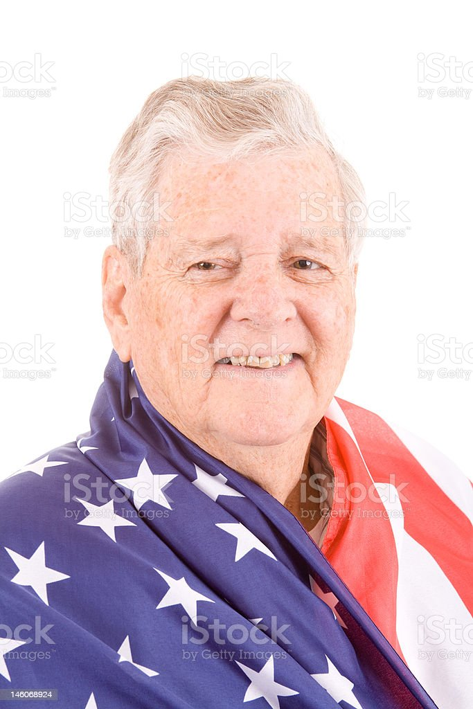 Patriotic Senior Caucasian Man Wrapped in American Flag, Isolated Background stock photo