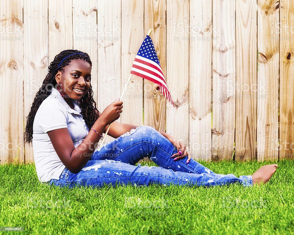 Patriotic Teen Girl with American Flag royalty-free stock photo