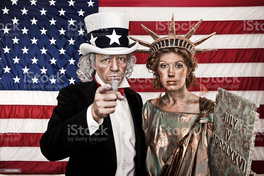 Patriotic Uncle Sam and Lady Liberty Want YOU! stock photo