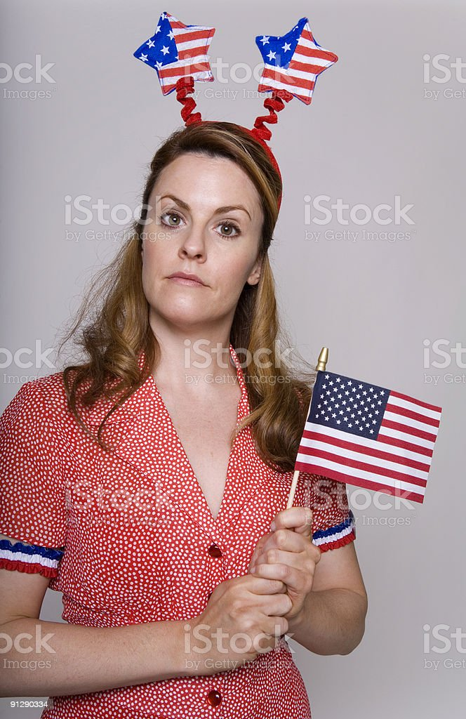 Patriotic young woman celebrates the Fourth of July royalty-free stock photo