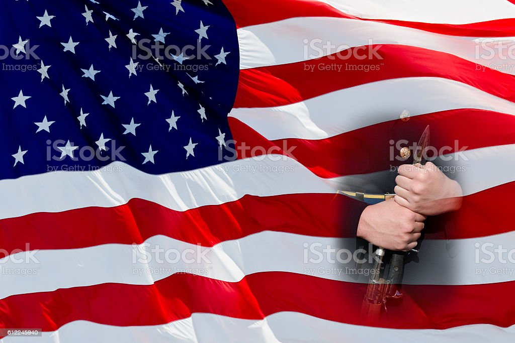 Patriotism -- American Flag With Soldier Holding Rifle and Bayonet stock photo