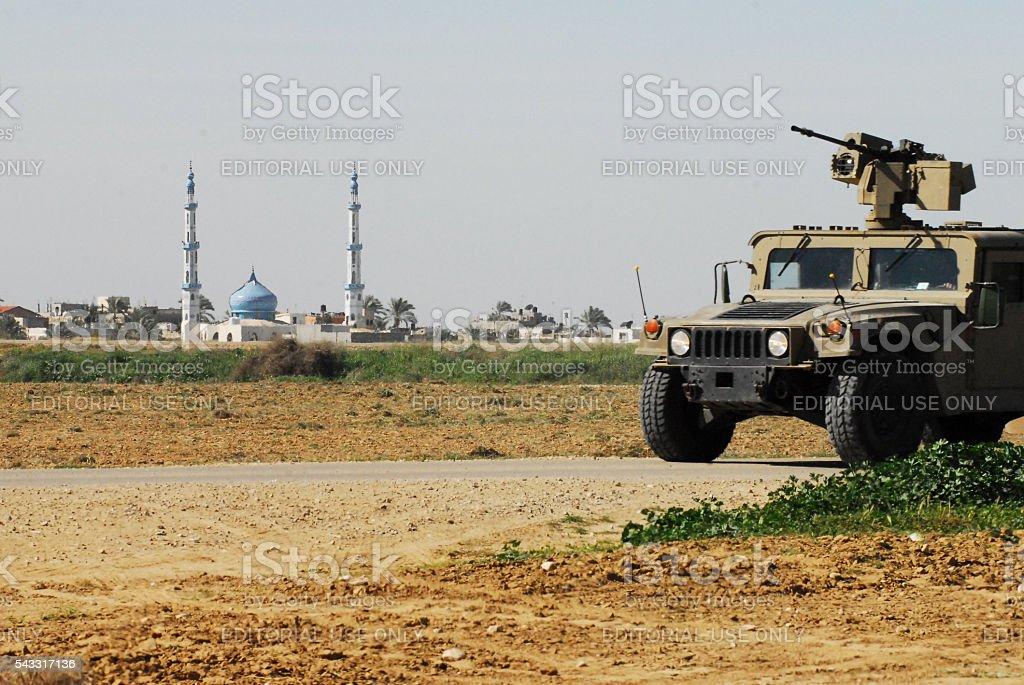IDF patrol along Gaza strip border fence stock photo