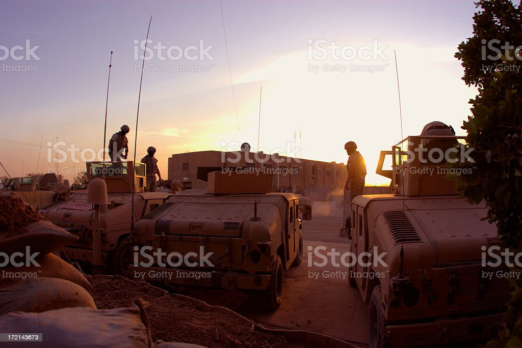 HMMWV Patrol on a nice day at sunset stock photo