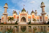 Pattani central mosque with reflection in Thailand.