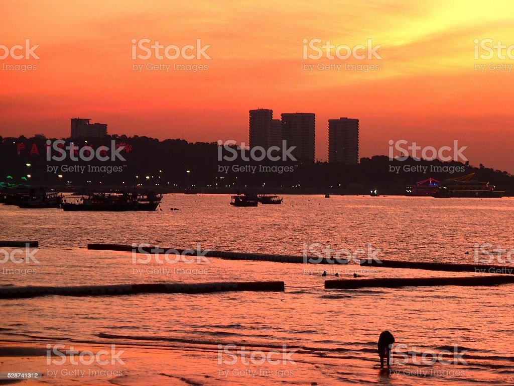 Pattaya beach at sunset, Thailand stock photo