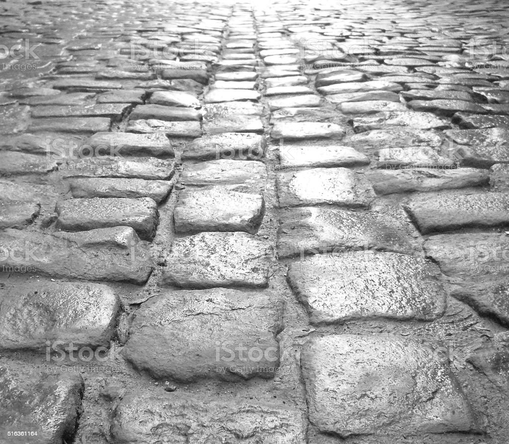 Pattered cobblestone street. stock photo