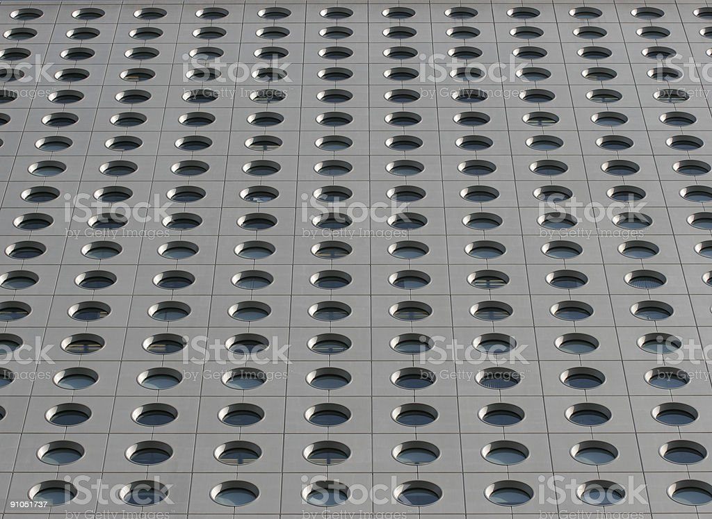 Pattern formed by round windows of a highrise office block royalty-free stock photo