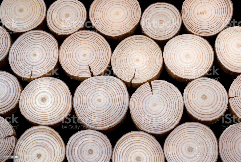 Pattern from many  pine saw cuts on black background. stock photo