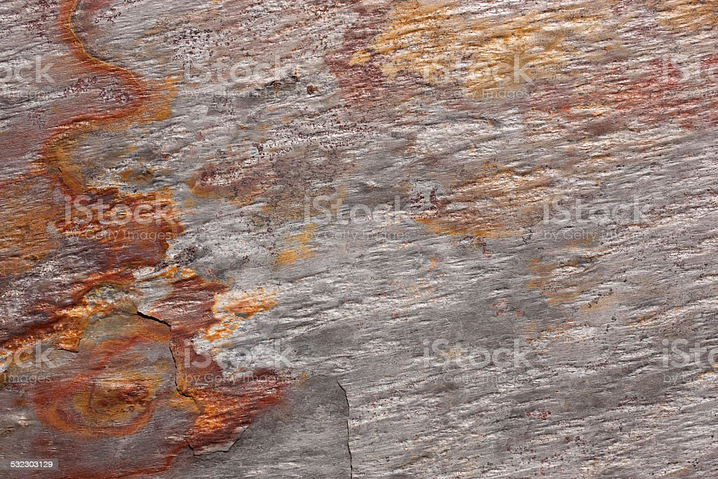 Pattern of a stone slab in silver-gray and rust royalty-free stock photo