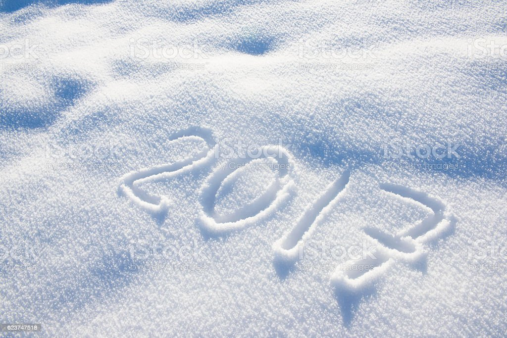 pattern of fresh powder snow with new year 2017 stock photo