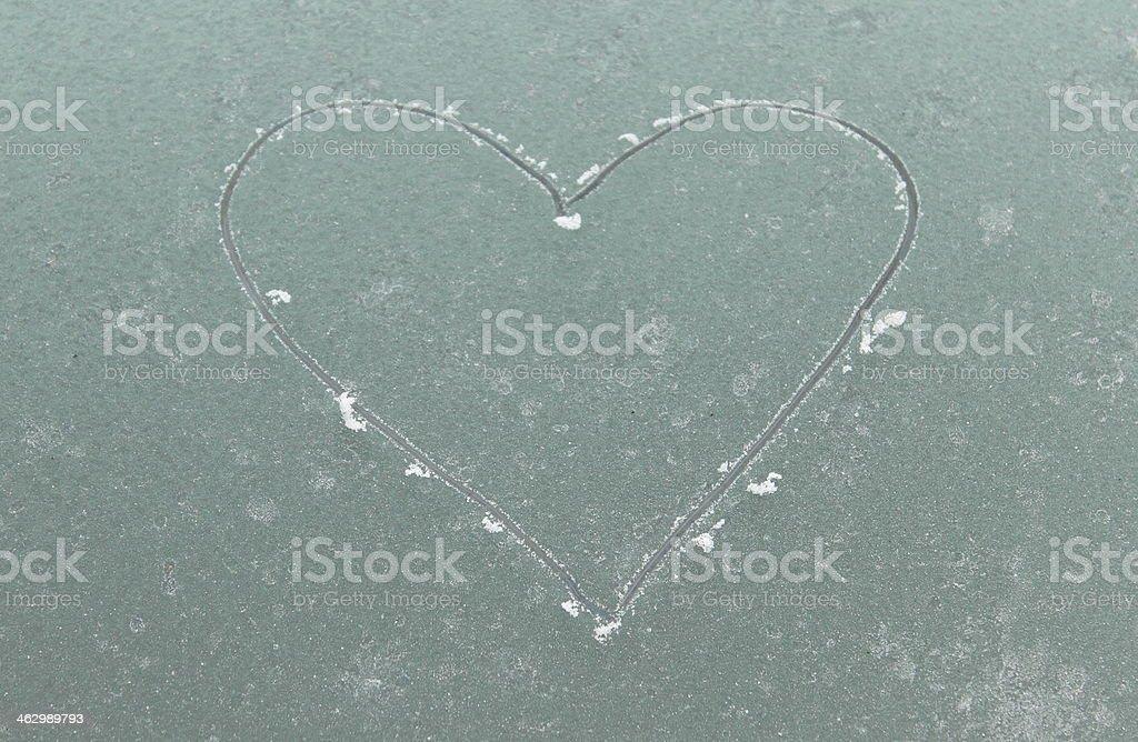 Pattern of frozen heart on window stock photo