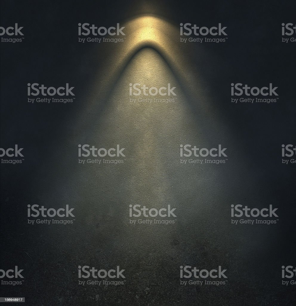 pattern of light on dark wall stock photo