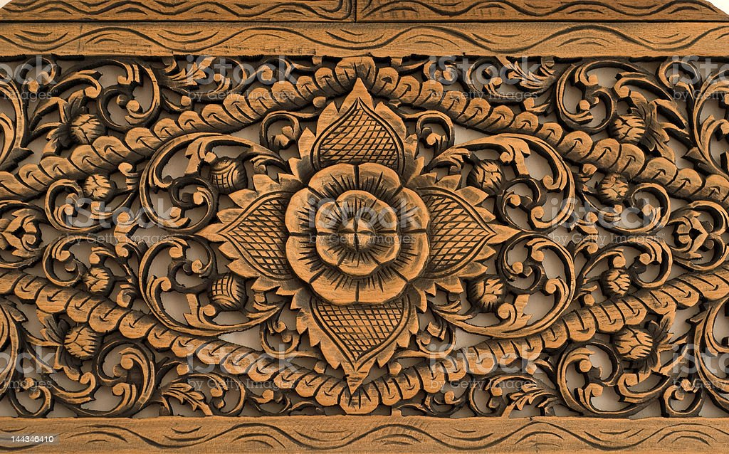 Pattern of rose carved on wood stock photo
