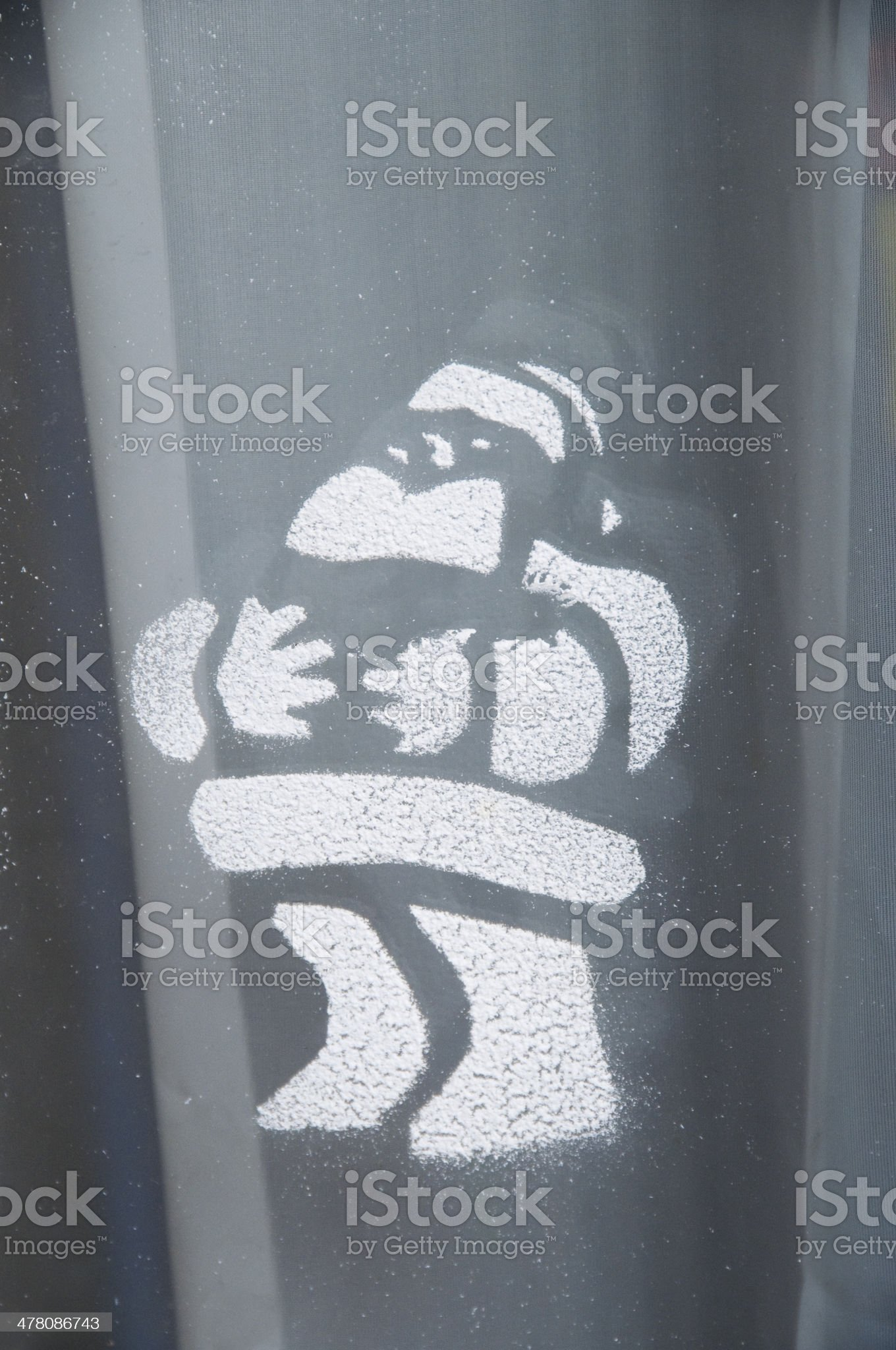 Pattern of snowed Santa Claus on window royalty-free stock photo