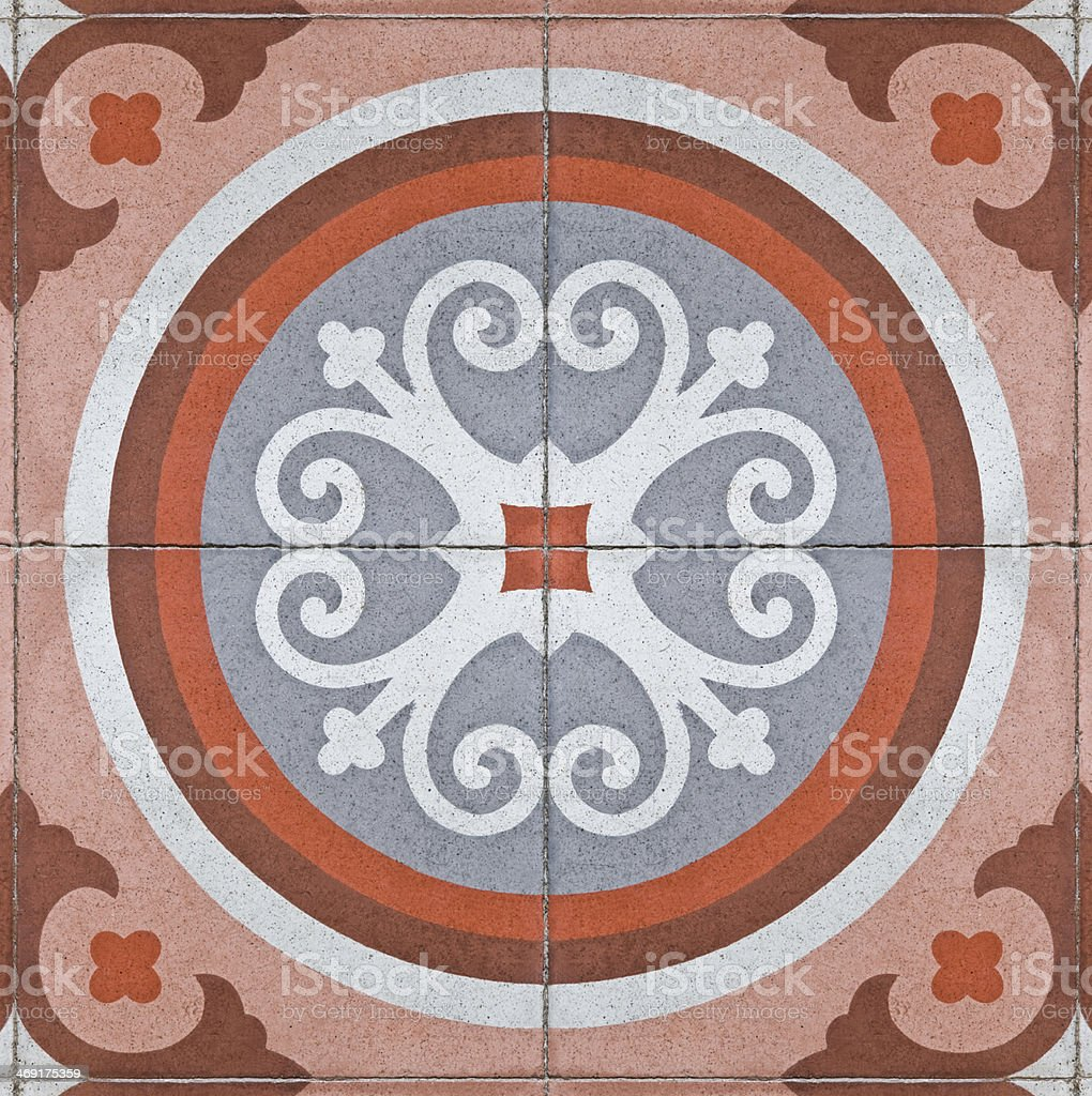 pattern on an ancient square paving tile royalty-free stock photo