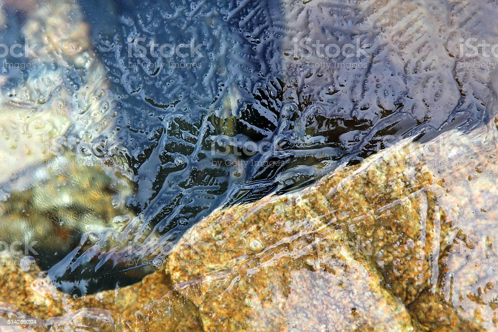 Pattern on the surface of the ice stock photo