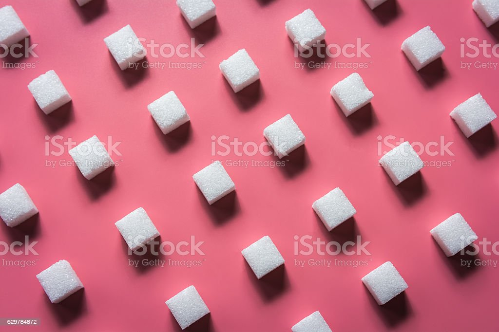 Pattern Sugar Cubes on a Pink Background stock photo