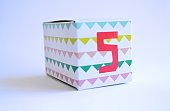 patterned cardboard box with number five on it