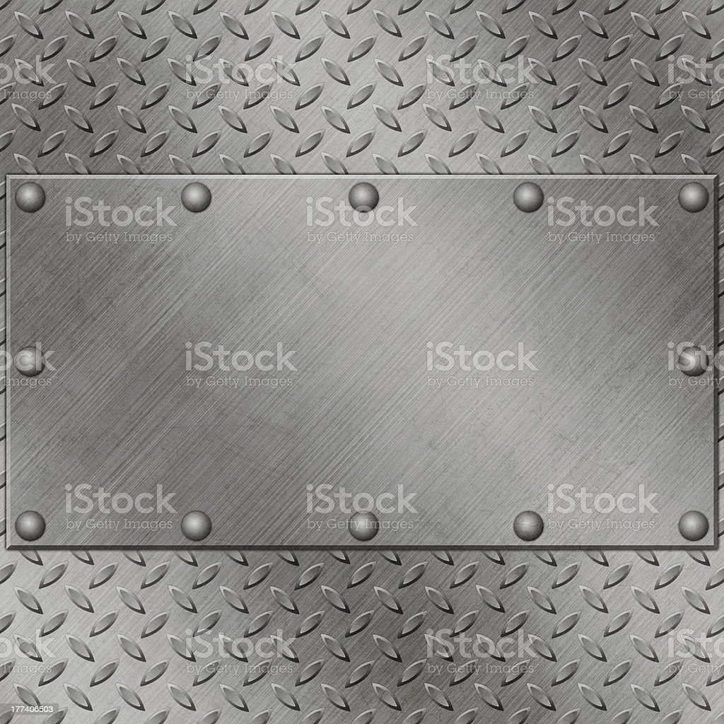 Patterned metal background with empty metal rectangle atop stock photo