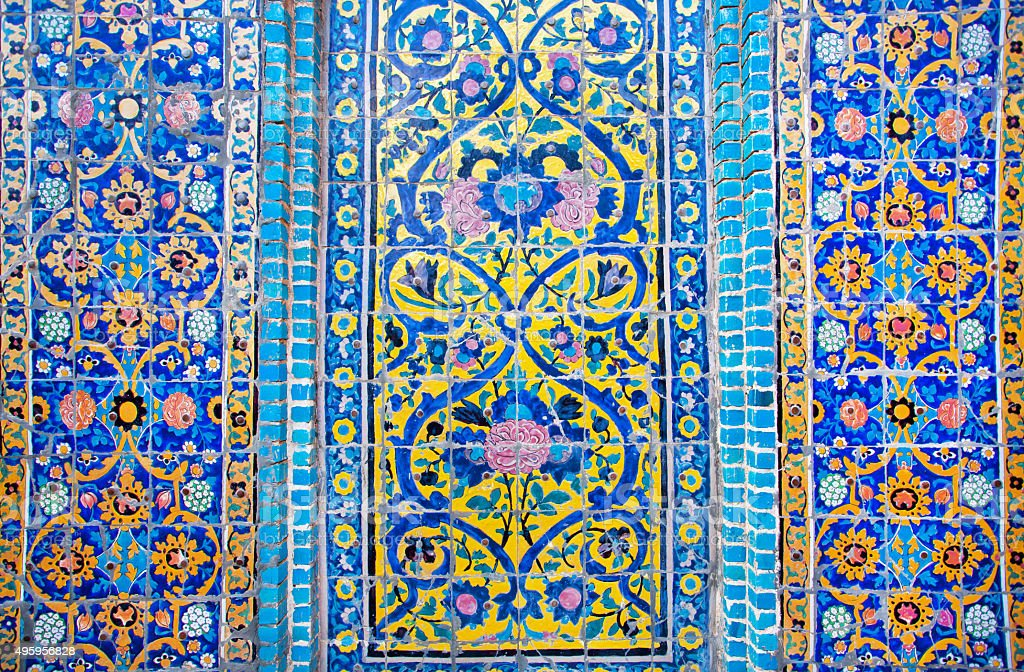 Patterned wall with tiles of historical persian building in Iran stock photo