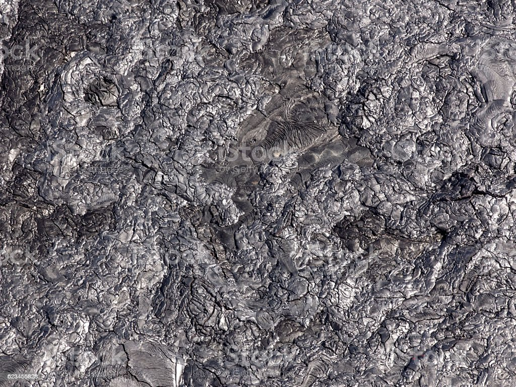 Patterns cracks and shapes from solidified lava, Hawaii stock photo