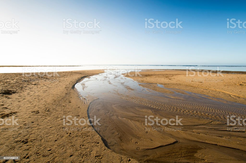 Patterns in the sand at low tide stock photo