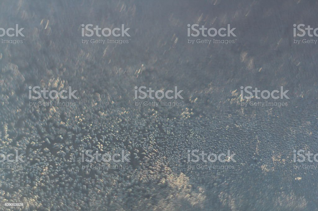 Patterns made by the frost on the  window. Hoarfrost background. Selective focus. stock photo