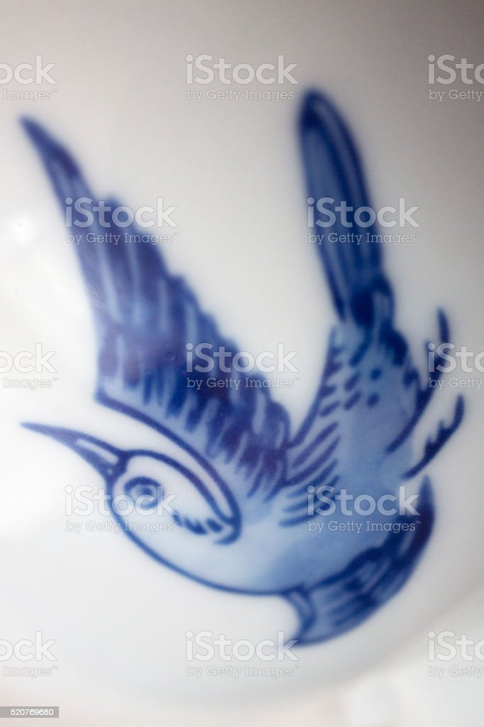 Patterns of china plate showing bird stock photo