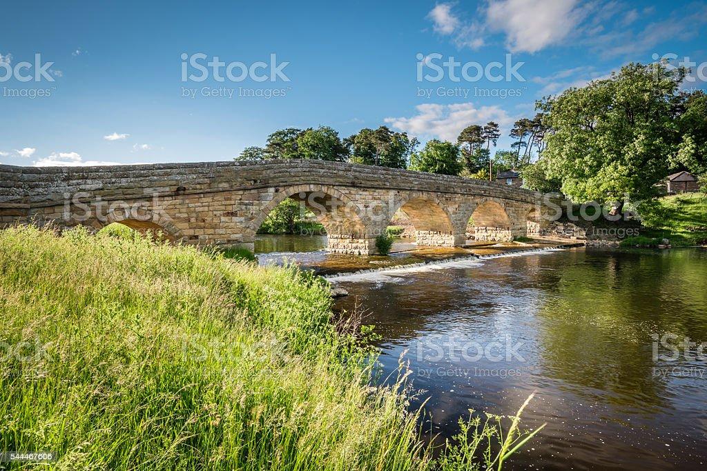 Pauperhaugh Bridge and weir stock photo