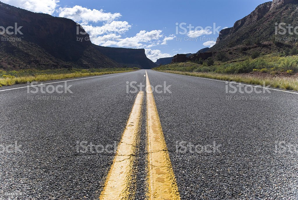 Paved Road with Passing Stripes MOving Forward royalty-free stock photo