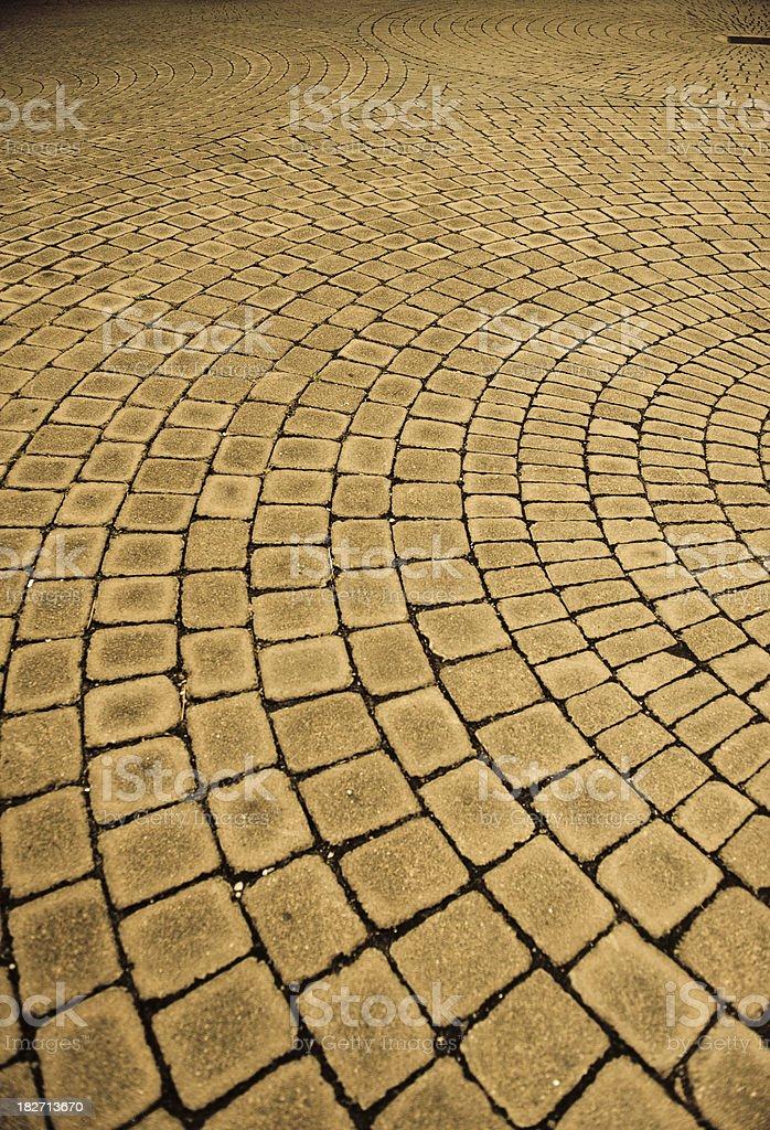 Pavement brick pattern swirl sepia royalty-free stock photo