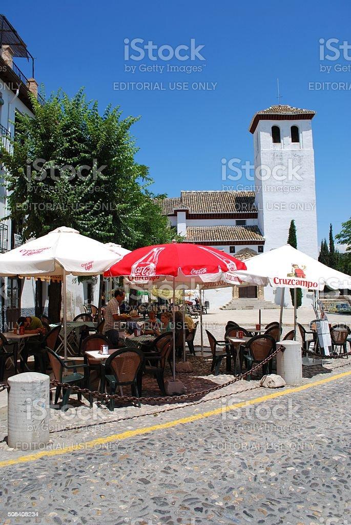 Pavement cafe and church, Granada. stock photo