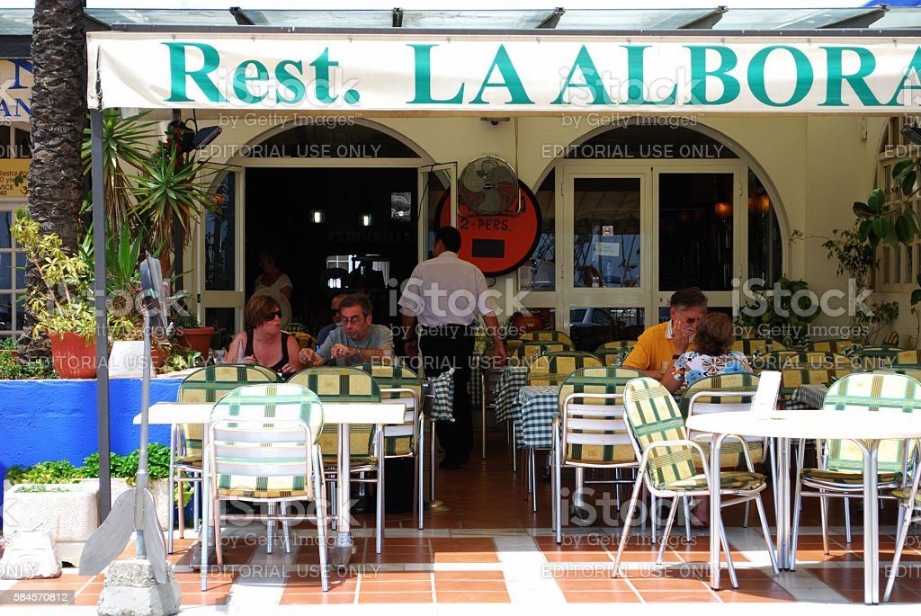 Pavement cafe in the harbour area, Estepona. stock photo