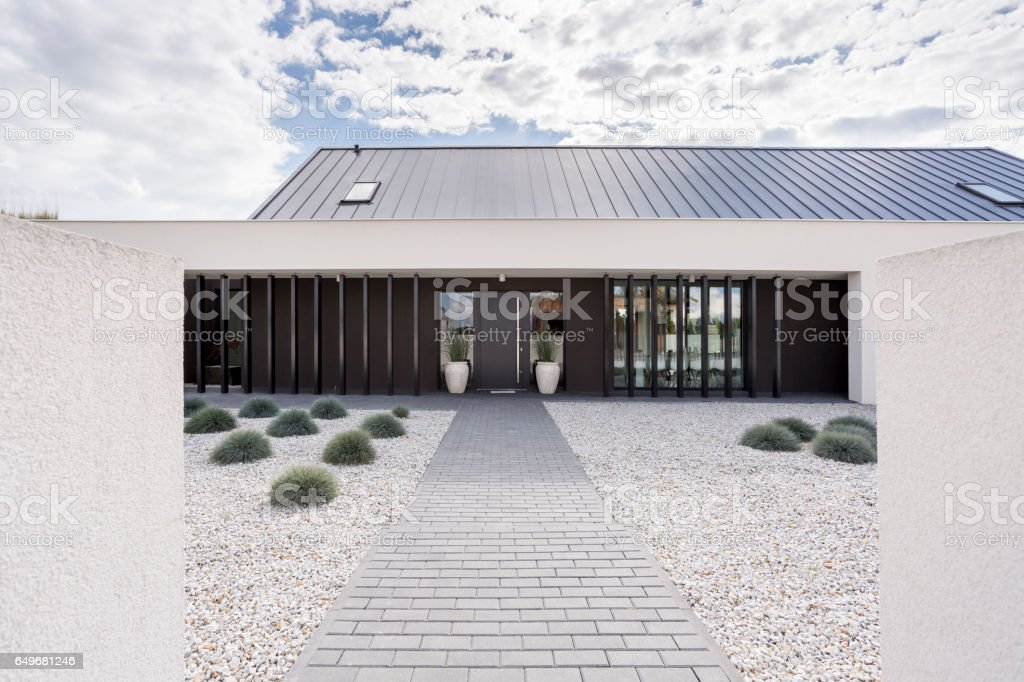 Pavement leading to house stock photo