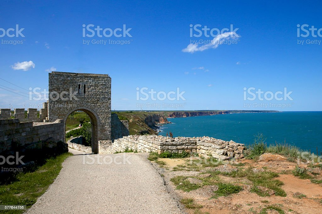 Pavement leads into the arch in fortress wall stock photo