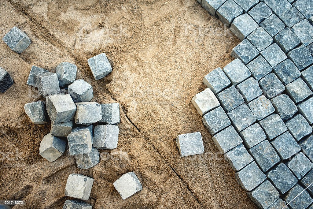 Pavement rocks, stones and cobblestone blocks, construction of path stock photo