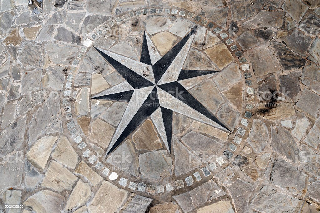 Pavement Stone with Compass Rose stock photo