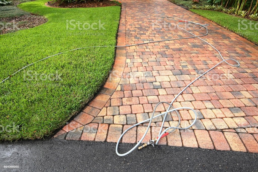 Paver driveway pressure cleaned stock photo