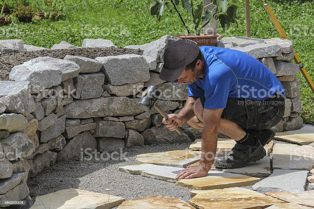 Paver in the garden with marble plates stock photo