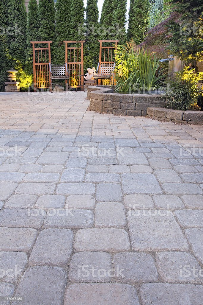 Paver Patio with Garden Decoration and Landscape Lights stock photo