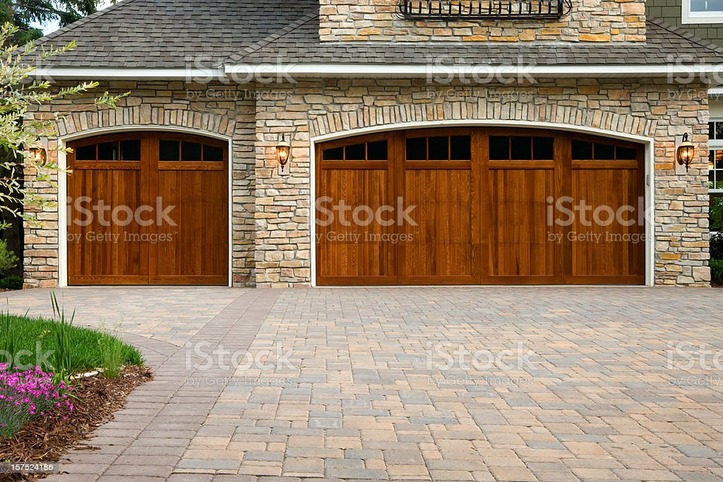 Pavers, custom doors, and stone on upscale home. stock photo