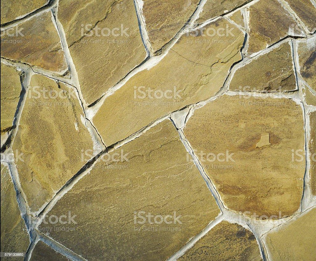pavers, stone, chopped, yellow, beige, wall cladding stock photo