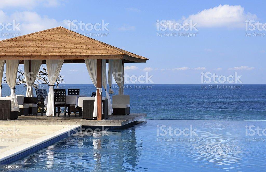 Pavilion and swimming pool near Atlantic Ocean stock photo