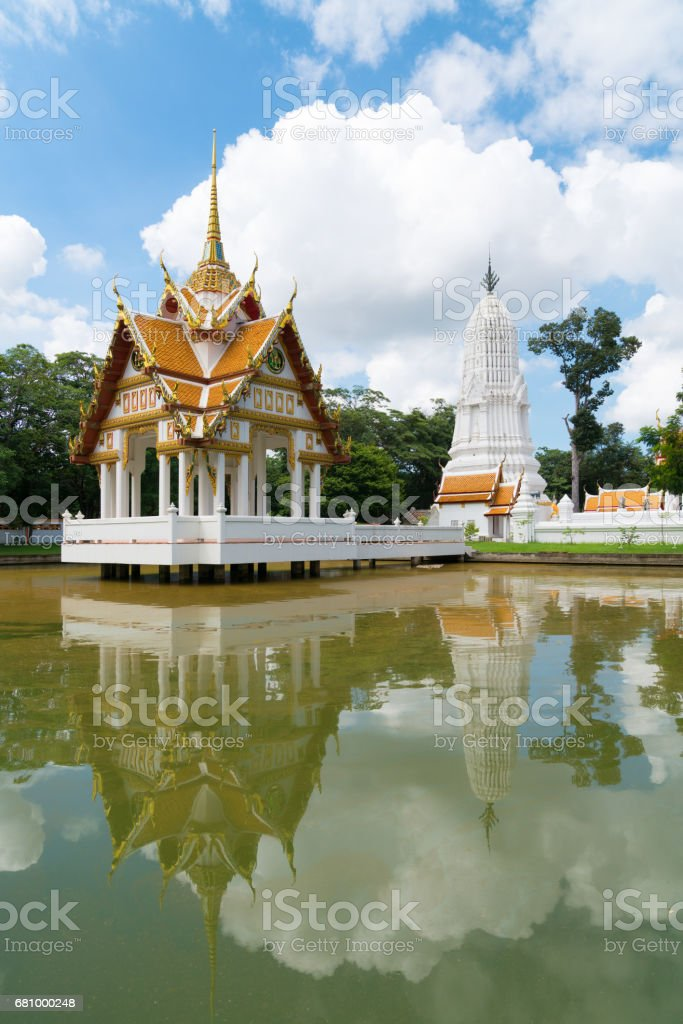 A pavilion and white stupa in a middle of a pool in Wat Kasattra, Ayutthaya, Thailand stock photo