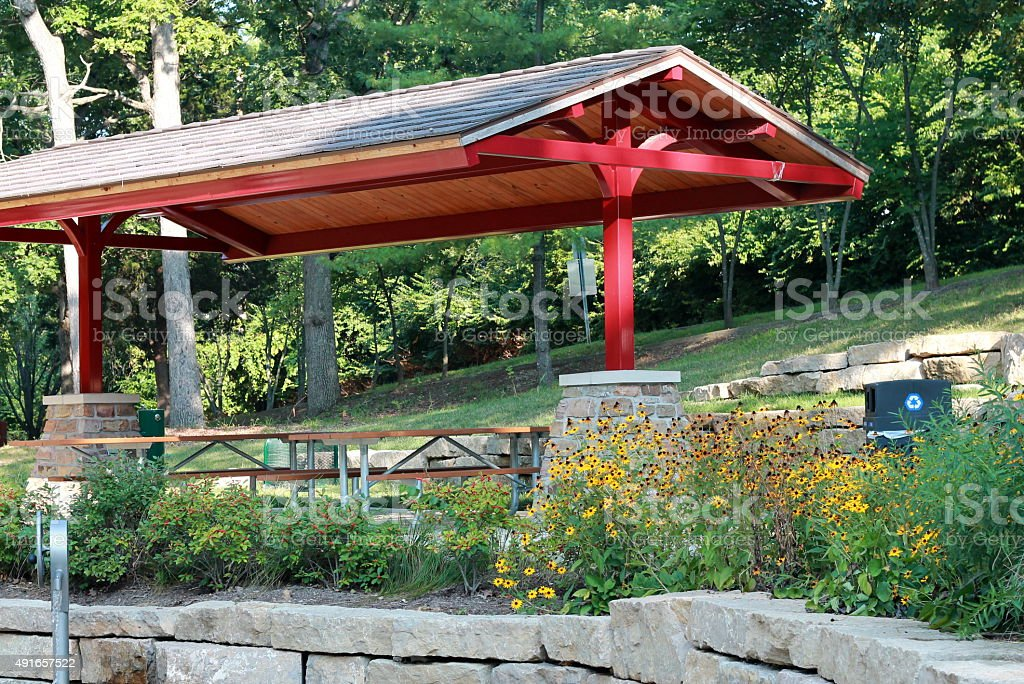 Pavilion with picnic tables at a park stock photo