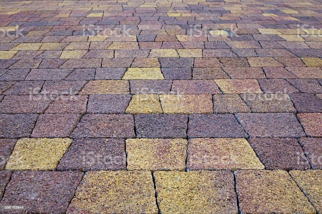 Paving Stone On Road Of Purple And Yellow Colors stock photo