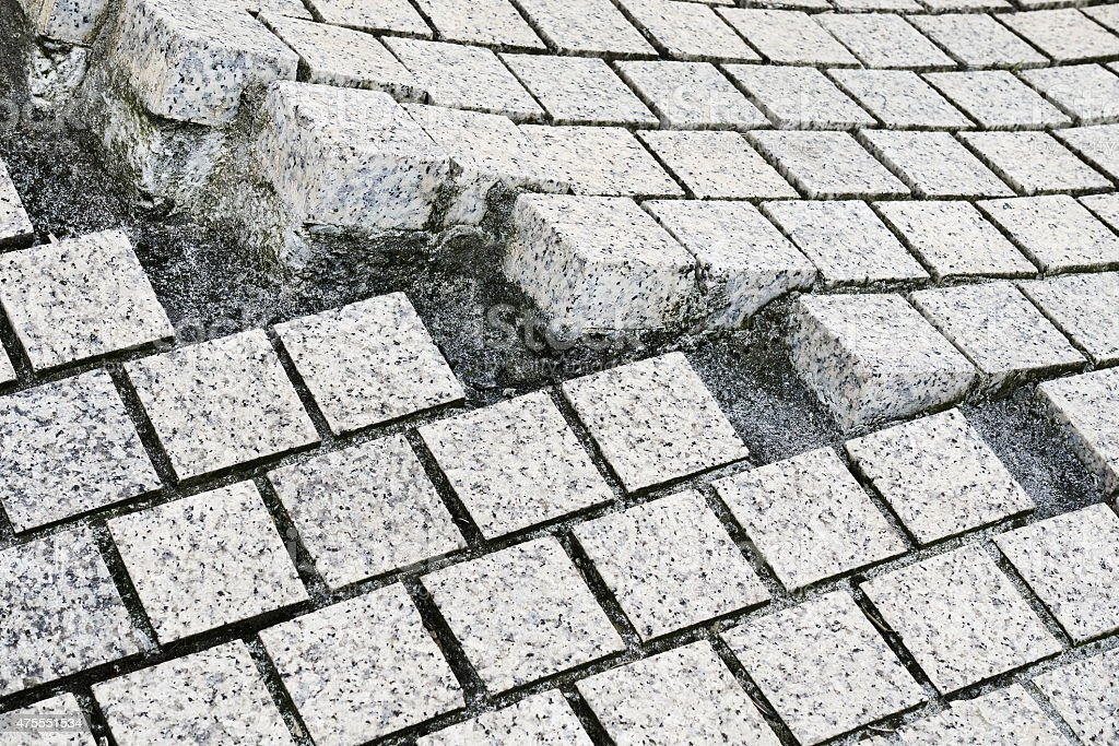 paving stones broken and cracked stock photo