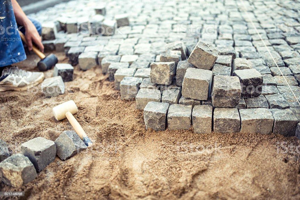 Paving stones on pavement terrace, construction details of cobbl stock photo