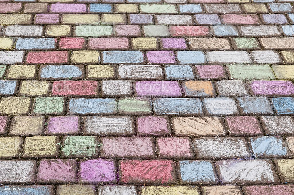 Paving stones painted with colorful Street Chalk stock photo